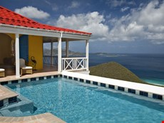 Photo of Colorful Caribbean Villa Overlooking Long Bay Beach