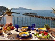Photo 1 of Stunning Sorrento Coast apartment with views of sea and Capri within walking distance to private beach, small seaside village